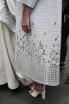 Fabric Embellishment - long jacket with white & silver petal pattern; modern applique; textiles design detail // Queenie Chan