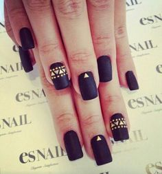 Matte black nails with gold triangle embellishment