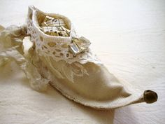 Sweet wee fairy shoe!  http://www.etsy.com/listing/83734773/sweet-elf-fairy-shoe-ornament-tutorial?ref=sr_gallery_34&sref=&ga_search_submit=&ga_search_query=ornament&ga_view_type=gallery&ga_ship_to=US&ga_search_type=handmade&ga_facet=handmade