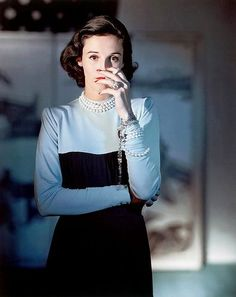 Mrs. Stanley Grafton Mortimer Jr (Babe Paley) wearing a Creation of Traina-Norell, photographed by Horst P. Horst from American Vogue in 1946.
