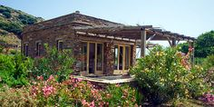 Onar, an eco-resort in a rare protected wetland on the eastern coast of Andros, one of the Greek Cycladic islands Andros Greece, Corfu, Porches, Stone Cabin, Eco Cabin, Greece Hotels, Hotel Concept, Stone Houses, Beach Cottages