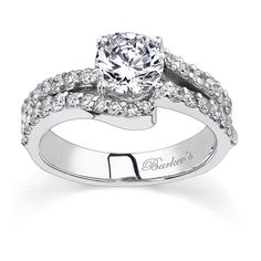 White Gold Engagement Ring - 7320LW - This classic, elegant white gold diamond engagement ring features a prong set round diamond center.  The split shank is adorned with shared prong set diamonds, and the cathedral shoulders curve to cradle the center at the sides.  A diamond ridge embellishes the shoulders for an added look of sophistication.  Also available in 18k and Platinum.