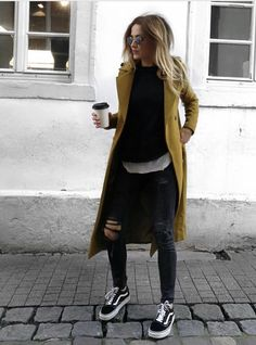 Yellow coat jeans and sneakers