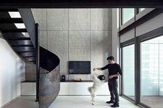 Modern apartment with a sleek sculptural staircase