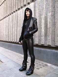 "there's a game I play when I see chic people all dressed in black: ""goth or fashion student?"" she comes down just on the side goth - check the fringe, the bird-skull necklace, and the boots - but oh so well done."