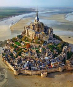How incredible is this ancient castle town that looks straight out of a Disney fairytale? 🏰 — This is Mont Saint-Michel, France, at low tide 🇫🇷😍 Tag someone that should see this!👇 — Photo courtesy of Mont Saint Michel France, Le Mont St Michel, Beautiful Places To Visit, Cool Places To Visit, Places To Travel, Travel Destinations, Camping Places, Vacation Ideas, Nature Architecture