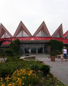 Tamarack: Tourist destination located at Exit 45 of the WV Turnpike. Features a red peaked roof & landscaped grounds that draw over 500,000 visitors annually. This large arts & crafts facility is run as an economic development project of the WV Parkways Authority & sells WV craft products, such as wood, glass, textiles, pottery, metal, jewelry, specialty food items, fine art, and WV books & recordings. There are 5 resident artisan studios.