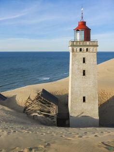 Fearing the next storm. The abandoned Rubjerg Knude lighthouse makes its way through the dunes.
