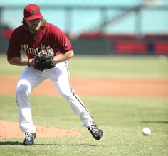 The Arizona Diamondbacks' Wade Miley fields during a drill as his team trains at the Sydney Cricket Ground in Sydney, Wednesday, March 19, 2014. The MLB season-opening two-game series between the Los Angeles Dodgers and Arizona Diamondbacks in Sydney will be played this weekend. (AP Photo/Rick Rycroft)