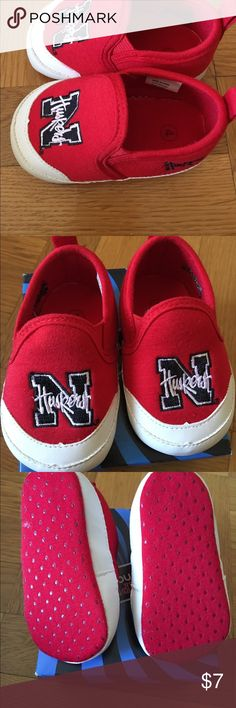 Baby Slip-on Shoes Nebraska Cornhuskers These cute lightweight baby shoes are brand new. They have never been worn. They are perfect for a little Husker fan (girl or boy). They are size 4 (9 to 12 months). Campus Footnotes Shoes Flats & Loafers