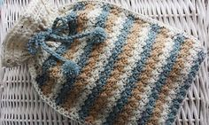 """This pattern is for a cover approx 14""""/36cm x 10""""/26cm, but instructions are given for making a smaller or larger one."""