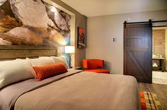 Warm hues and rustic design make Hotel Indigo Traverse City the perfect addition to the Warehouse District neighborhood.