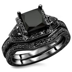 This shimmering beauty will make a graceful addition to her ring finger. Our black diamond engagement ring set is handmade in expert detail. This unique bridal set features a luxurious black diamond engagement ring with twisted accents along either side o Engagement Rings Princess, Princess Cut Rings, Gold Engagement Rings, Princess Cut Diamonds, Engagement Ring Settings, Black Gold Jewelry, White Gold Rings, Silver Ring, Bridal Ring Sets