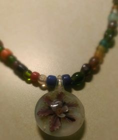Bead Necklace with Glass Flower Charm by IndigoCrush on Etsy