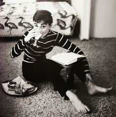 Audrey Hepburn eating and studying