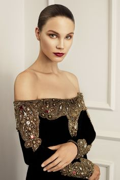 Dilek Hanif. Heavily beaded cuffs and necklace on black velvet. Classic.