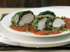 Swiss chard is filled with chicken breast and aromatics, then served on a bed of tomato sauce for a vibrantly heart meal.