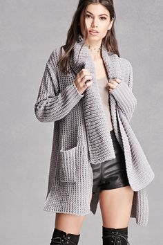 A chunky ribbed knit cardigan featuring an open-front, shawl collar, draped silhouette, two front patch pockets, a vented hem, and long sleeves. This is an independent brand and not a Forever 21 branded item.