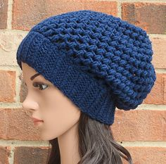 Very professional looking beanie that looks snug, not constantly slipping. Ravelry pattern.
