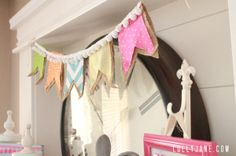 Cute and Easy Spring Pom-Pom Banner from Lolly Jane