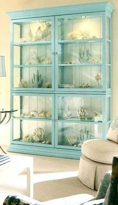 Love this cabinet! I would mix and put some other things in with the shells and such .