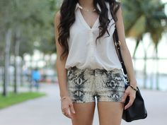 i love the snakeskin shorts and that bag!!