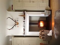 Wood stove in fireplace surround.MY favorite set up for a wood-burner, but with a flat screen above the mantle. Log Burner Fireplace, Wood Burner, Small Log Burner, Fireplace Surrounds, Beautiful Interiors, Home Living Room, Ideal Home, Family Room, New Homes