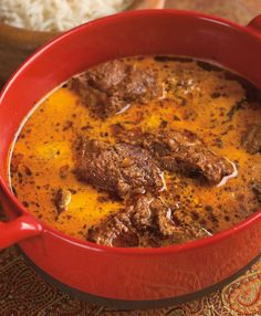 """Lamb is stewed tender in a luscious curry of green cardamom and buttermilk in this recipe from """"Vij's At Home: Relax, Honey""""."""
