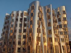 Gehry: Der Neue Zollhof building    One third of a wild office complex designed by -- you guessed it -- Frank O. Gehry. This pic was taken with the setting sun providing some beautiful soft (and golden) lighting.