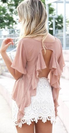 Pink cascading ruffle open back blouse. White lace overlay skirt, shorts, white skinny jeans.