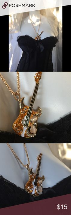 Betsey Johnson Rockstar Guitar Pendent Necklace Brand New Betsey Johnson Guitar Pendent Necklace. Channel Your Inner Rockstar with this Glitzy Glam-Star, Rhinestone Studded Rock Guitar Pendent Necklace. Betsey Johnson Jewelry Necklaces