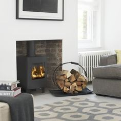 the Morsø is a stunning example of a small stove offering all the attributes of a larger model. The viewing area is maintained and indeed at its most visually appealing in this format. Buy now from Bradley Stoves Sussex Living Dining Room, Home And Living, Small Stove, House Interior, Living Room Decor, Home Living Room, Front Room, Log Burner Living Room, Fireplace