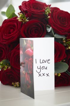 Say I Love You the traditional way with a hand-written love letter and a bouquet of red roses