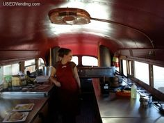 cooking arrangement in an old school bus turned restaurant