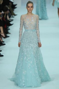 Elie Saab Bridal Gown: Non-traditional brides will love floating down the aisle wearing an elegant Elie Saab masterpiece that looks as if it's glistening with thousands of intricate ice crystals. Don't you just love the pale blue hue?