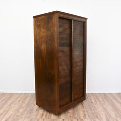 This large wardrobe is featured in a solid wood with a glossy walnut finish. This armoire is in great condition with 2 sliding shutter doors, a large interior cabinet and a clothing rack shelf. Great for storing and organizing clothing! #traditional #dressers #armoireorwardrobe #sandiegovintage #vintagefurniture