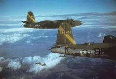 """Martin B-26 Marauders including (U2-F, serial number 42-95828) nicknamed """"Kreihl's Cradle"""" and (9F-K, serial number 43-34401) nicknamed """"Helen Highwater III"""" of the 397th Bomb Group fly in formation during mission,February 1945"""