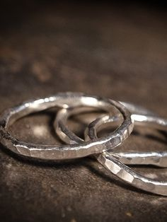 Sometimes simplicity makes the biggest statement of all.Hand-forged and fused from pure reclaimed silver, these rings are striking in their minimalistic elegance. The hammered texture gives the rings a subtle shimmer and a touch of glamour.Stunning alone; impressive stacked together.Priced individually.Please indicate ring size in message when you place your order.•*¨`*•✿  ✿•*¨`*•AHIMSA DESIGNS - Yoga, Zen & Vegan Jewelry By Kristen Anderson - Original HandCrafted, Sterling Silver Jewelry…