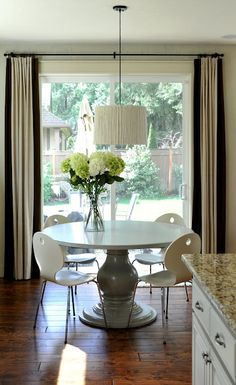 Fabulous DIY Table & Bamboo Pendant.  Redo with Zinc color & aluminum chairs w/gold mid century chandelier