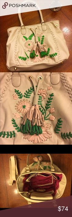 ⚜️💐ISABELLA FIORE cream floral handbag👛🌴 Ravishing, genuine leathered Isabella Fiore medium cream handbag. Used a few months, minor scuffs. Overall great condition. Tassels are leather as well. Extremely soft. Bright pink lining ! Cross body I never used but are included. Has original labels. The large floral embroidery is a bright pink 🌷and beautiful green🍃. I hope you fall in love with it just as I did! Isabella Fiore Bags Totes