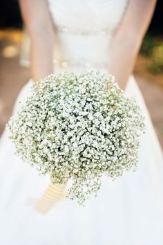 The bride and bridesmaid bouquets were made entirely out of baby's breath, accented with a cheery yellow-and-white striped ribbon.