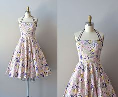 """vintage 1950s dress / cotton 50s sundress / Mayenne by DearGolden, $275.00  Vintage 1950s cotton halter sundress with illustrative floral print, black piping trim, bust darts, fitted waist, full skirt and metal side zipper.   ✂-----Measurements  fits like: xs bust: 32"""" waist: 25"""" hip: free length: 35.5"""" from top of the bodice brand/maker: Sportlane Deb condition: excellent"""
