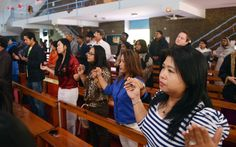 Christians offer prayers during a Christmas mass at the Fatima Church in Islamabad, Pakistan.
