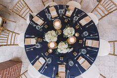 Wedding Reception Table Decor with Navy Blue Linens, Gold Napkins, Candlelight, and Ivory Floral Centerpieces | Palmetto Wedding Planner Special Moments | Bradenton Wedding Florist Iza