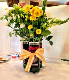 A simple floral arrangement for a tennis social and Any flowers would look nice.