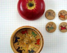 vintage wooden apple roulette toy with horses
