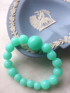 Check out this item in my Etsy shop https://www.etsy.com/listing/233612360/turquoise-green-acrylic-bead-bracelet