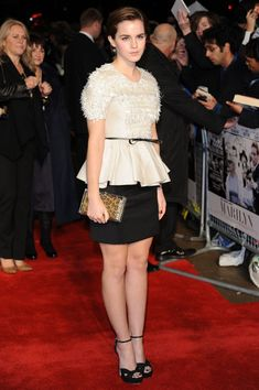 Emma Watson Platform Sandals    Emma Watson was chic in black and white at the 'My Week with Marilyn' premiere in London. Emma topped off her peplum top with black platform sandals.