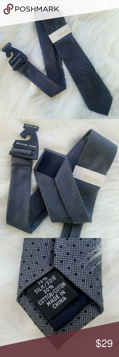 MICHAEL KORS Tie Black and Gray polka dot tie by Michael Kors. Never worn, tag still attached. 70% silk, 30% cotton.  Check out the rest of my closet for a selection of other ties. MICHAEL Michael Kors Accessories Ties