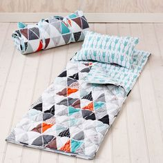 With a wonderful diamond quilted texture, the Tonto sleeping bag from Adairs Kids features a gorgeous print of geometric triangles with cool blue arrows on the inside. Complete with a sleeping bag and mini pillow, this set can be rolled up for convenient storage and features carry handles making it perfect for sleepovers and travel.